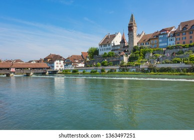 Bremgarten, Switzerland - June 16, 2018: buildings of the historic part of the town along the Reuss river. Bremgarten is a municipality in the Swiss canton of Aargau, known for its medieval old town.