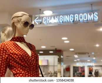 BRENT CROSS, LONDON - APRIL 3, 2019: Mannequins model clothes and accessories outside the changing rooms at Topshop woman's fashion retail store inside Brent Cross Shopping Centre in North London, UK.
