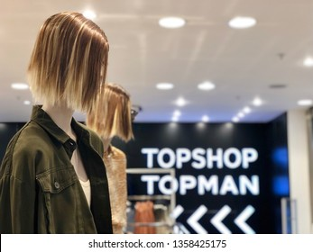BRENT CROSS, LONDON - APRIL 3, 2019: Female mannequins model clothes inside Topshop and Topman fashion retail shops at Brent Cross Shopping Centre in North London, UK.