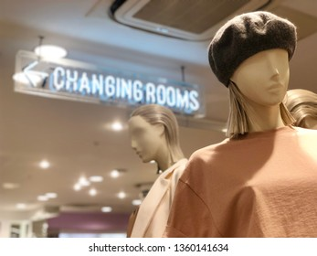 BRENT CROSS, LONDON - APRIL 3, 2019: Mannequins model clothes outside changing rooms inside Topshop fashion shop at Brent Cross Shopping Centre in North London, UK.