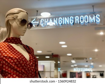 BRENT CROSS, LONDON - APRIL 3, 2019: Clothes and fashion accessories adorn mannequins outside the changing rooms at Topshop woman's retail store inside Brent Cross Shopping Centre in North London, UK.