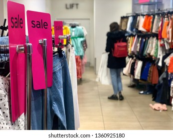 BRENT CROSS, LONDON - APRIL 3, 2019: A female customers browses the sale section of Topshop fashion retail store at Brent Cross Shopping Centre in North London, UK.