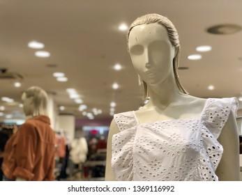 BRENT CROSS, LONDON - APRIL 3, 2019: Mannequins model clothes inside Topshop woman's fashion retail store inside Brent Cross Shopping Centre in North London, UK.
