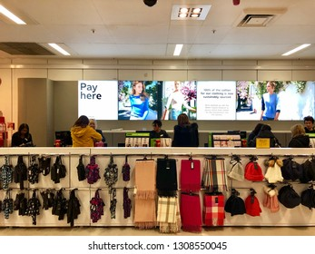 BRENT CROSS, LONDON - FEBRUARY 9, 2019: Customers pay for products at the checkout inside Marks and Spencer at Brent Cross shopping centre in North London, UK.