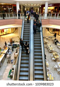 BRENT CROSS, LONDON - MARCH 6, 2018: People using escalators move between floors at Brent Cross Shopping Centre in Barnet, North London, England, UK.