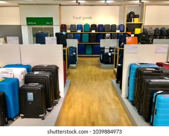 BRENT CROSS, LONDON - MARCH 6, 2018: Suitcases and luggage for sale in the travel goods section of the John Lewis department store at Brent Cross Shopping Centre in Barnet, North London, England, UK.
