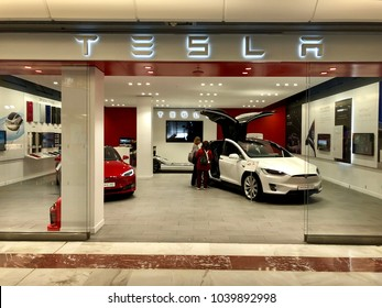 BRENT CROSS, LONDON - MARCH 6, 2018: Model S and Roadster vehicles on display inside a Tesla Motors Store at Brent Cross Shopping Centre in Barnet, North London, England, UK.