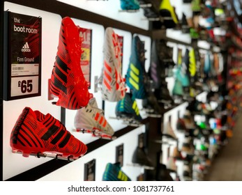 BRENT CROSS, LONDON - MAY 2, 2018: Football boots for sale at Sports Direct in Brent Cross, North London, UK.