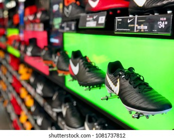 BRENT CROSS, LONDON - MAY 2, 2018: Football boots on display at Sports Direct in Brent Cross, North London, UK.