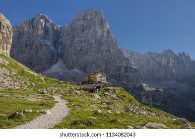 Brentei refuge, Brenta valley, Brenta Dolomites, Italy-August 21, 2013: Located under Crozzon de Brenta mountain pillar with Cima Tosa summit as seen from trail #318 from Tuckett  to Brentei refuges