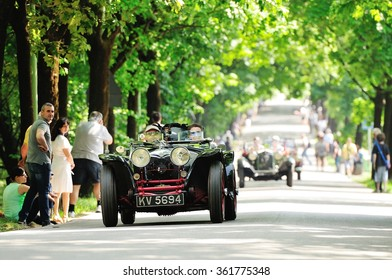 BRESCIA (BS), ITALY - MAY 14: A black and red Riley prototype, followed by OOF classic cars, takes part to the 1000 Miglia classic car race on May 14, 2015 in Brescia (BS). The cars was built in 1933.