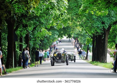 BRESCIA (BS), ITALY - MAY 14: A green Bugatti T40 Grand Sport, and a green OOF Aston Martin, take part to the 1000 Miglia classic car race on May 14, 2015 in Brescia (BS). The cars were built in 1929.
