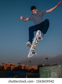 Brescia, Italy, 11.15.2018: Skateboarding skate men males boys sports wallpaper