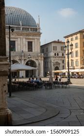 Brescia, Italy - 17 September, 2019: Corner view on the Loggia Palace (Palazzo della Loggia) - that is Brescia City Hall,  Piazza della Loggia and ancient buildings.