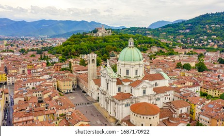 Brescia, Italy. Cathedral of Santa Maria Assunta. Flight over the city in cloudy weather, Aerial View