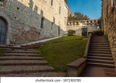 Brescia, Italy - December, 2015: the beautiful medieval castle of the city of Brescia in the evening against a bright blue sky. Part of Brescia castle. Castello di Brescia, Lombardy, Italy. Travelling