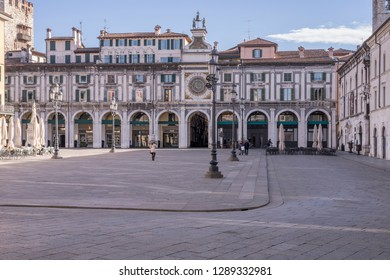 BRESCIA, ITALY - JANUARY 30: bright winter sun lightens old  facades on central Loggia  square of historical town , shot in bright winter light on jan 10, 2019 at Brescia, Italy