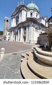 Brescia /Italy – July 18,2017. Brescia is a beautiful Lombard city where the cathedral is the Cathedral of Santa Maria Assunta on Paolo VI pope square near  the Broletto palace with its ancient tower.