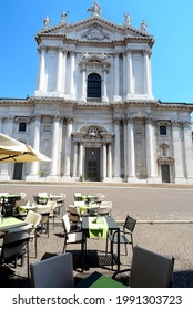 Brescia -Italy – July 18,2017. Brescia is a beautiful Lombard city where the cathedral is the Cathedral of Santa Maria Assunta on Paolo VI pope square near  the Broletto palace with its ancient tower.