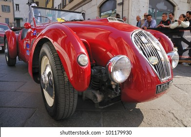 BRESCIA, ITALY - MAY 12 : A 1950 built red Healey Silverstone waits for the sealing (final compliance check) for 1000 Miglia race on May 12, 2011 in Brescia.