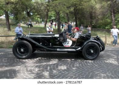 BRESCIA, ITALY - MAY 14:Driver Alejandro Pablo Oxenford on ALFA ROMEO 6C 1750 GS Spider Zagato, 1931 built on Mille Miglia,the famous race for retro cars, May 14,2015 in Brescia,Italy