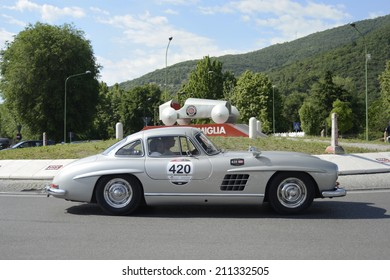 BRESCIA, ITALY - MAY 15: A silver-gray Mercedes 280W Gullwing drives before the 1000 Miglia monument at the 1000 Miglia classic car race on May 15, 2014 in Brescia. This car was built in 1957