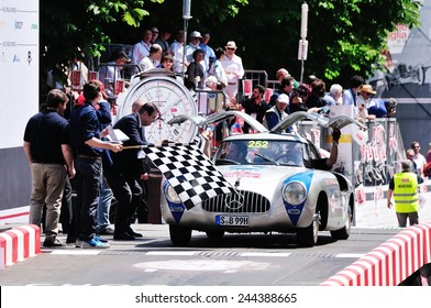 BRESCIA, ITALY - MAY 18: Jochen Mass finishes the 1000 Miglia classic car race on May 18, 2014 in Brescia. The former F1 driver drives a Mercedes 300 SL W Carrera built in 1952