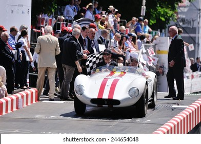 BRESCIA, ITALY - MAY 18: A red-striped white Maserati A6 GCS/53 Fantuzzi finishes the 1000 Miglia classic car race on May 18, 2014 in Brescia. The car was built in 1954