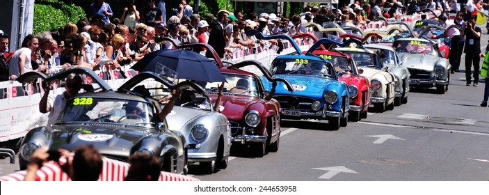 BRESCIA, ITALY - MAY 18: Seven Mercedes Gullwing in a row, and a single Porsche 356, take part to the 1000 Miglia classic car race on May 18, 2014 in Brescia. The car were all built in 1955