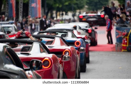 "Brescia, Italy - May 19, 2018: Cars participating in the ""Ferrari Tribute"" line-up at the finish of the historic Mille Miglia automobile race in Brescia, Italy."