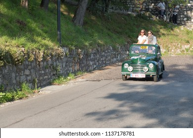 Brescia, Italy - May 19 2018: FIAT 500 C TOPOLINO 1951 is an old racing car in rally Mille Miglia 2018, live shot at the famous italian historical race on May 19 2018 in Brescia, Italy.