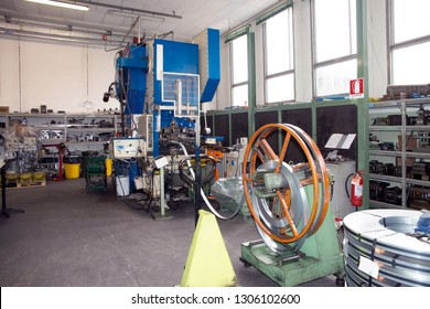 BRESCIA, ITALY - May 2, 2018 - This Italian industry designs a wide range of metal stamping dies required for different categories of products and specifications - Workshop - Metal forming press.