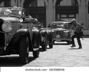 Brescia, Italy - May 2015: Mille Miglia 2015 edition. Arrival of a historic car in Piazza della Loggia in Brescia.
