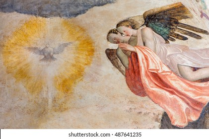 BRESCIA, ITALY - MAY 21, 2016: The fresco of angels adorating of Holy Spirit in church Chiesa del Santissimo Corpo di Cristo by Paolo da Caylina il Vecchio (circa 1501).