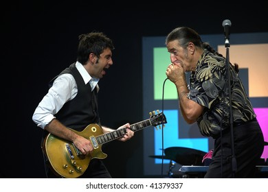 """BRESCIA, ITALY - OCTOBER 23 : Leader of the Italian blue band """"Treves Blues Band"""" Fabio Treves (R) plays the harmonica during a live concert October 23, 2008 in Brescia, Italy"""