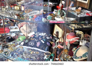 Brescia, Italy - October 7, 2017: Objects shop showcase with many strange and vintage items. Selective focus.