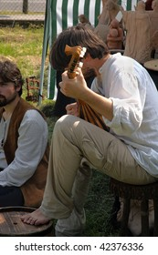 "BRESCIA,ITALY - APRIL 30: celebration of ""Medieval Day"", a lutenist sounds medieval songs  April 30,2005 in Brescia,Italy"
