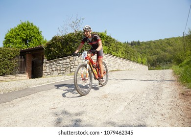 Brescia,Italy, April,22,2018 GF MTB race in Brescia Italy. Lot of bikers in action and village point.