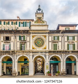 BRESCIA,ITALY - SEPTEMBER 26,2018 - Clock tower at the Loggia place in Brescia. Brescia is a city and comune in the region of Lombardy in northern Italy.