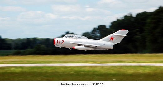 BRESLAU, ON, CANADA - JUNE 20: A Mig-15, a Russian aircraft type that won fame during the Korean War, takes off at the Waterloo Aviation Expo and Air Show on June 20, 2010 in Breslau, Ontario.