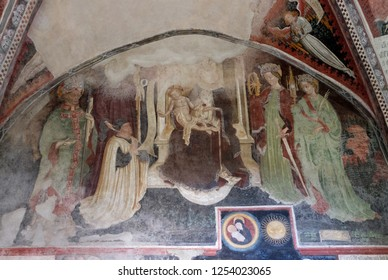 BRESSANONE, ITALY - JULY 14, 2018: Virgin Mary with baby Jesus and Saints, fresco in the cloister, Cathedral of Santa Maria Assunta and San Cassiano in Bressanone, Italy