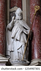 BRESSANONE, ITALY - JULY 14, 2018: Saint Albuinus  statue on the Cassian altar in the Cathedral of Santa Maria Assunta i San Cassiano in Bressanone, Italy
