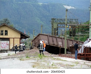 BRESSANONE, ITALY - JUNE 9, 2012: massive train crash derailment near the Bressanone station with paramedics and firefighters at work. Fireman at work near a wagon train derailed on June 9, 2012