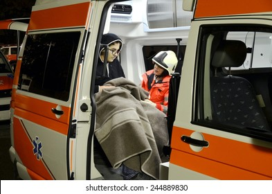 BRESSANONE, ITALY - NOVEMBER 16, 2014: A doctor examines patients inside an ambulance car near a hospital field tent for the first AID on November 16, 2014.