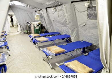 BRESSANONE, ITALY - NOVEMBER 16 2014: Empty hospital field tent for the first AID, a mobile medical unit of red cross. Camp room for the rescue of injured people after flood on November 16, 2014