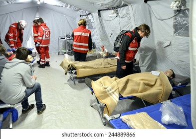 BRESSANONE, ITALY - NOVEMBER 16, 2014: A hospital field tent for the first AID, a mobile medical unit of red cross. Camp room for the rescue of injured people after flood on November 16, 2014.