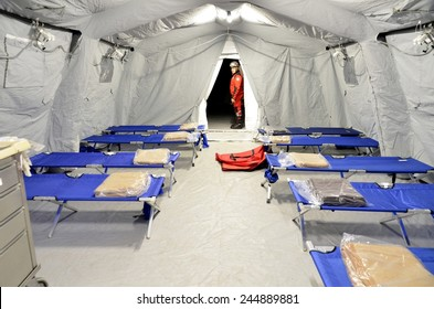 BRESSANONE, ITALY - NOVEMBER 16, 2014: Empty hospital field tent for the first AID, a mobile medical unit of red cross. Camp room for the rescue of injured people after flood on November 16, 2014.