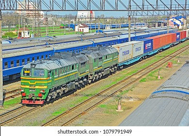 BREST, BELARUS - APRIL 14, 2018 - China-Europe freight train transporting containers at Brest-Tsentralny border railway station of Belarusian Railways (BCh)