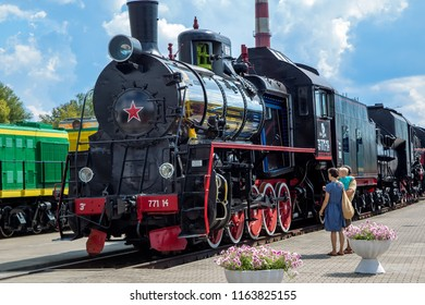 Brest, Belarus - August 18, 2018: Museum of steam locomotives in Brest. A steam locomotive with glass inserts, so that you can view the device of the boiler and other mechanisms.