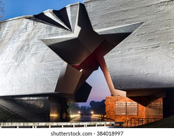 Brest, Belarus - February 26, 2016: Main entrance to Brest fortress with carved five-pointed star at night - view to hero soldier monument, Belarus. Brest fort first point attacked by Germans in USSR